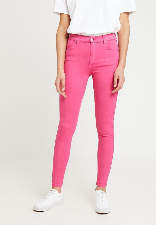 LEXY - Stoffhose - power pink