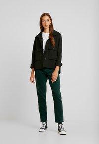 Dr.Denim - NORA - Pantalones - deep green - 2