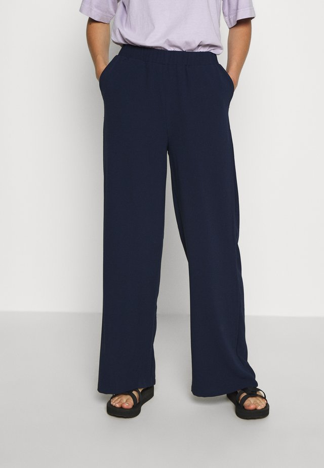 BELL TROUSERS - Trousers - black opal