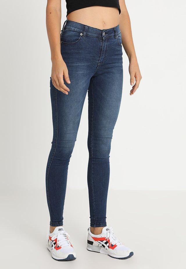 LEXY - Jeans Skinny Fit - worn dark blue