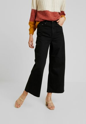 AIKO - Flared Jeans - black