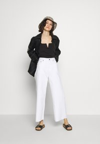 Dr.Denim - AIKO - Flared jeans - white - 1