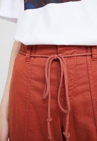 DRYKORN - BAD - Spodnie materiałowe - orange - 6