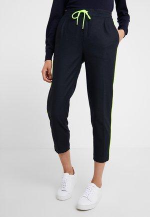 LEVEL - Trousers - navy/neon yellow