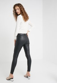 DRYKORN - WINCH - Leather trousers - black - 2