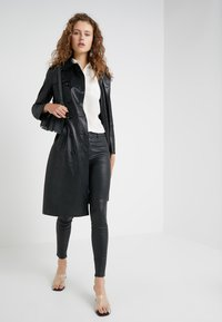 DRYKORN - WINCH - Leather trousers - black - 1