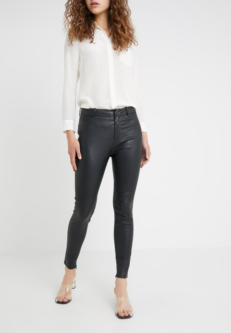DRYKORN - WINCH - Leather trousers - black