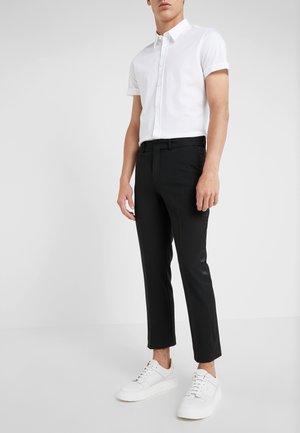 SIDE - Pantalones - black