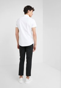 DRYKORN - SIDE - Spodnie materiałowe - black - 2