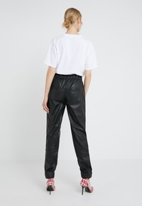 DRYKORN - ROPE - Kalhoty - black - 2