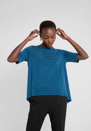 ESTELL - T-shirt imprimé - petrol