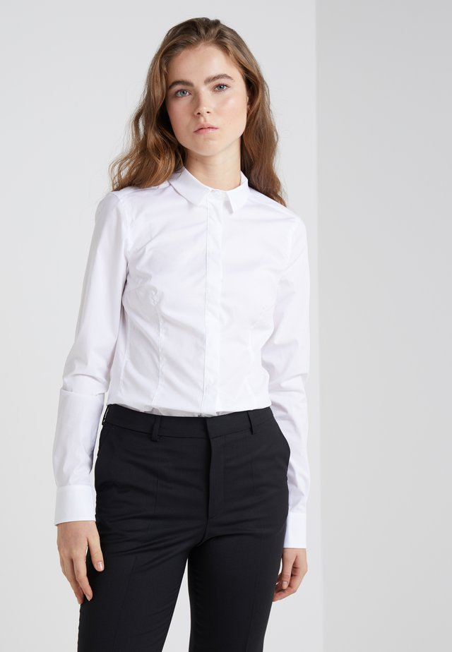 LIVY - Button-down blouse - white