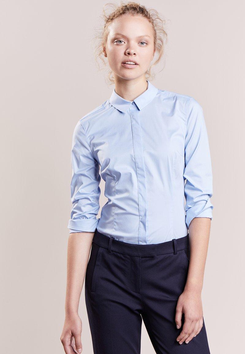 DRYKORN - LIVY - Button-down blouse - light blue