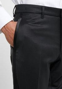DRYKORN - QUINTEN - Spodnie garniturowe - black - 3