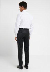 DRYKORN - QUINTEN - Spodnie garniturowe - black - 2