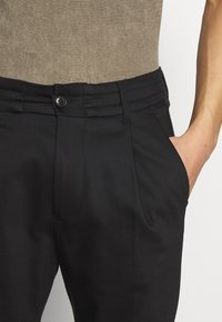 DRYKORN - CHASY - Trousers - black - 6