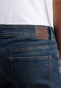 DRYKORN - JAW - Slim fit jeans - dark blue denim - 4