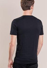 DRYKORN - CARLO - Basic T-shirt - black - 2