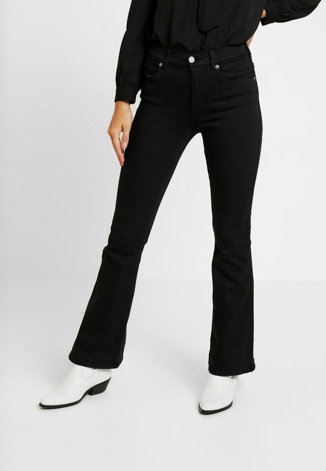 SONIQ - Flared jeans - black