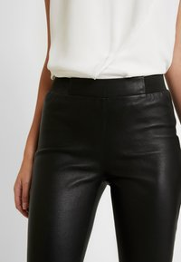 Dranella - FRUNA THEA FIT - Leather trousers - black - 4