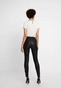 Dranella - FRUNA THEA FIT - Leather trousers - black - 2