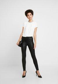 Dranella - FRUNA THEA FIT - Leather trousers - black - 1