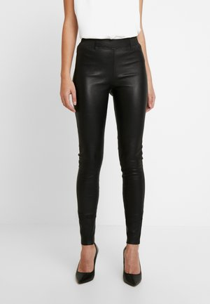 FRUNA THEA FIT - Leather trousers - black