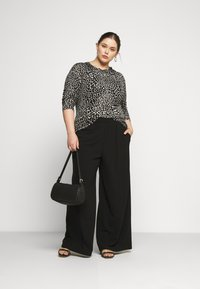 Dr.Denim Plus - BELL TROUSERS - Trousers - black - 1