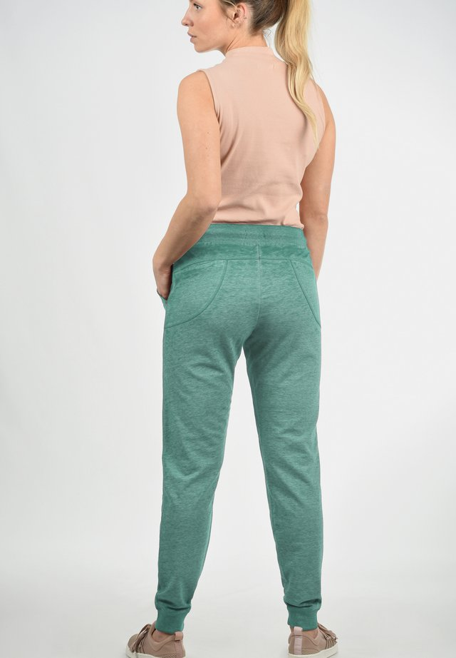 BETTY - Tracksuit bottoms - green