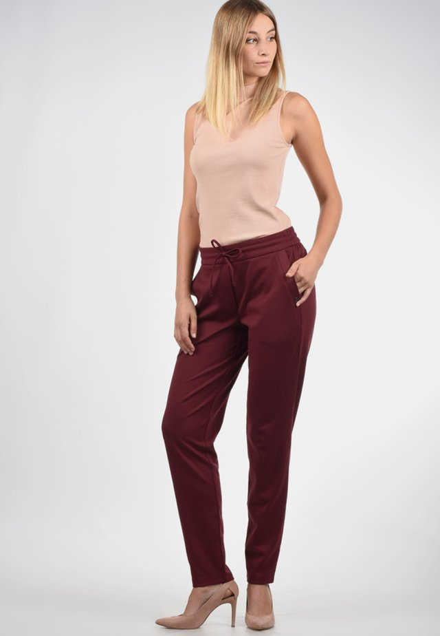 HEAVEN - Trousers - wine red