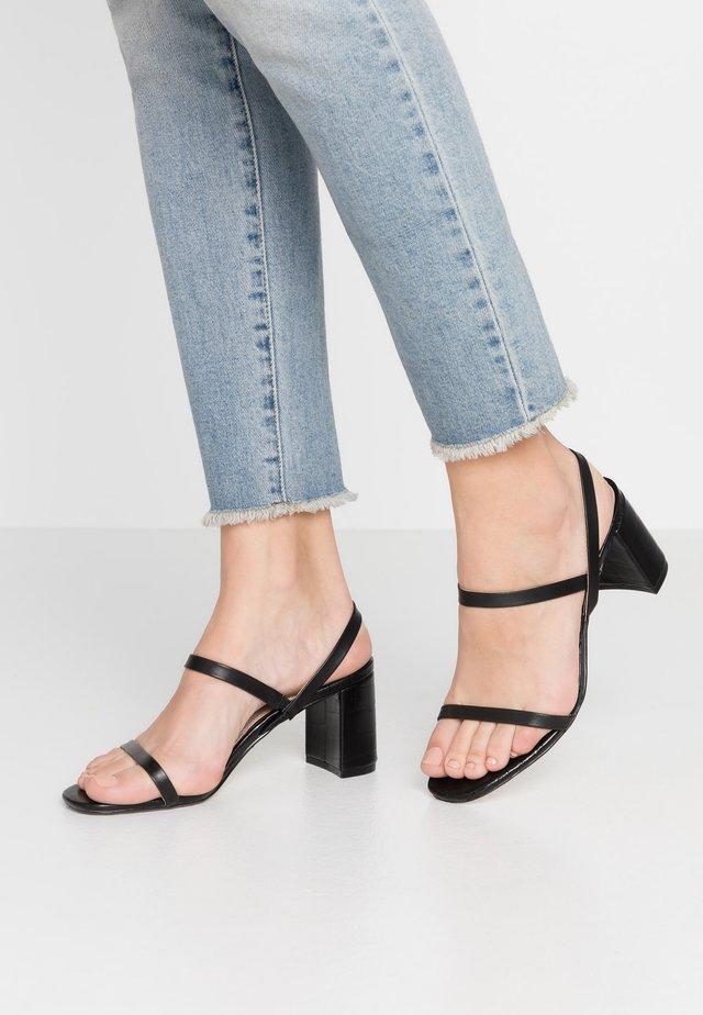 MARTA - Sandaalit nilkkaremmillä - black