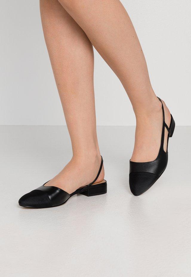 CORALLINA - Sandaalit nilkkaremmillä - black