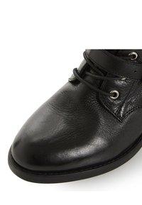 Dune London - Cowboy/biker ankle boot - black - 5
