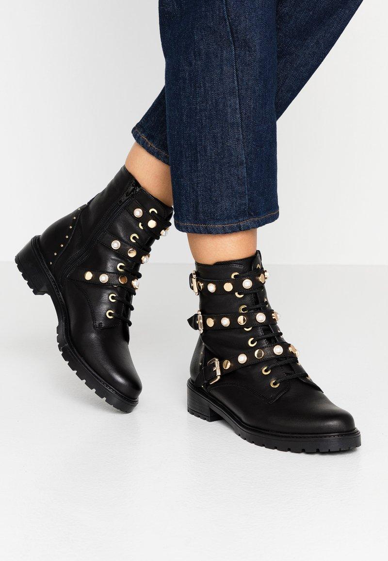 Dune London - REEGANS - Kovbojské/motorkářské boty - black