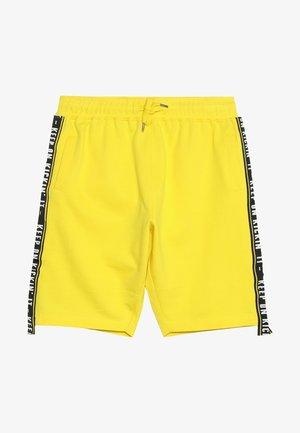 COSMO - Spodnie treningowe - cyber yellow