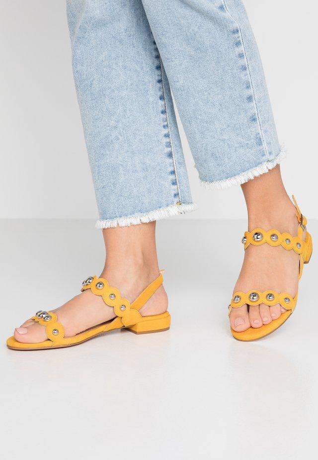 Sandales - aina