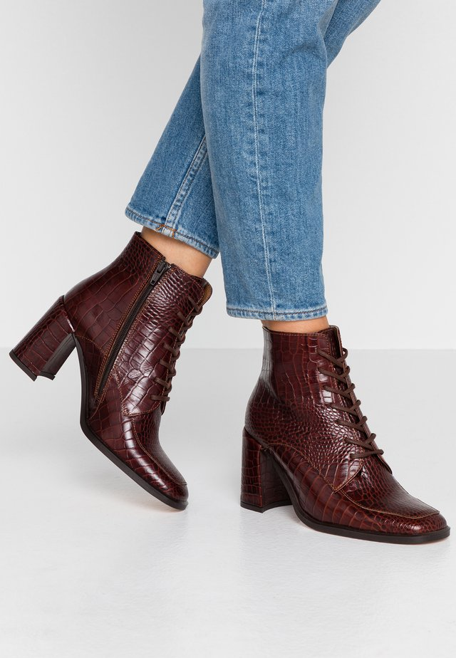 MALOU - Ankle boot - brown