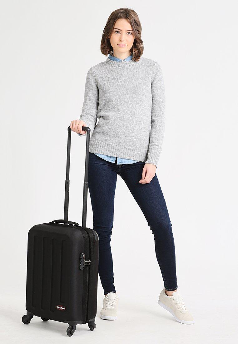 Eastpak - TRANZSHELL/CORE COLORS - Wheeled suitcase - black