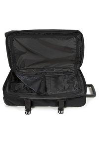 Eastpak - TRANVERZ M CORE COLORS - Wheeled suitcase - black - 6