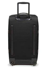 Eastpak - TRANVERZ M CORE COLORS - Wheeled suitcase - black - 3