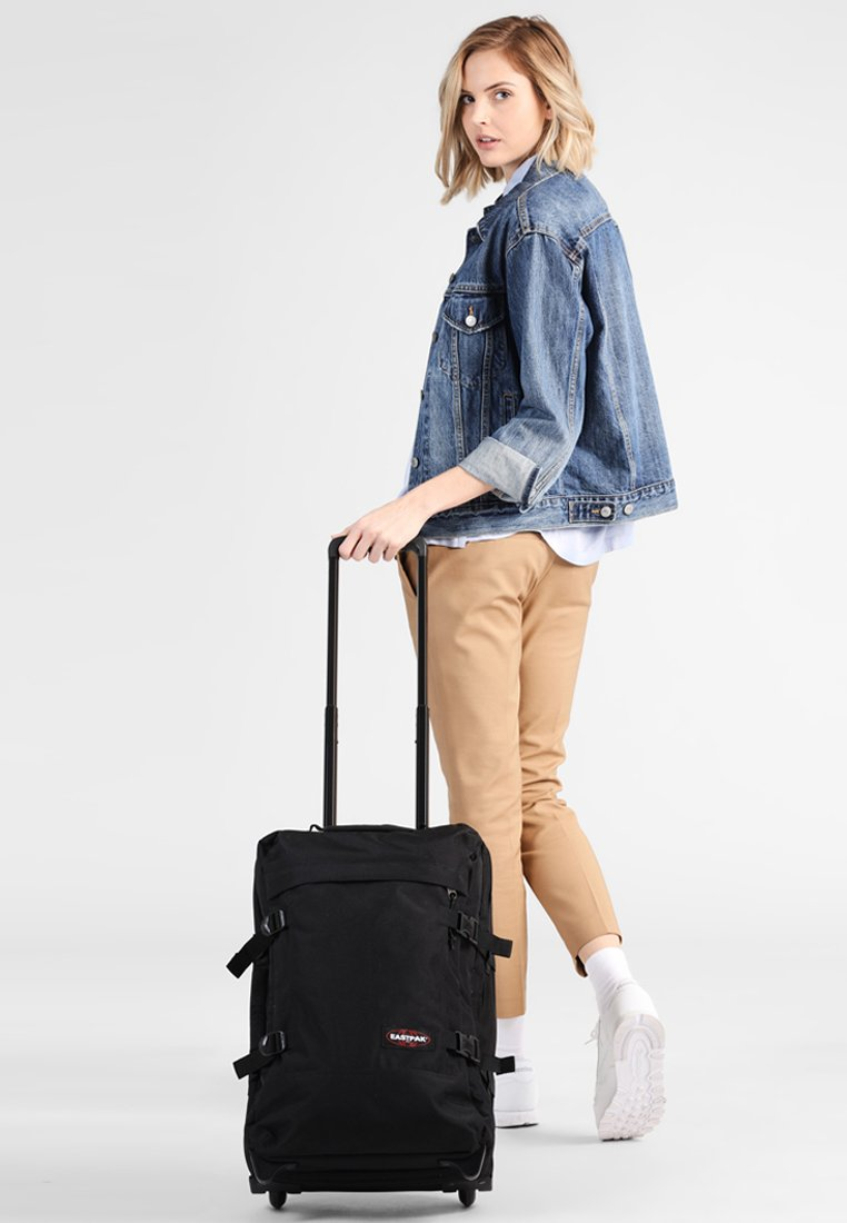 Eastpak - TRANVERZ - Wheeled suitcase - black