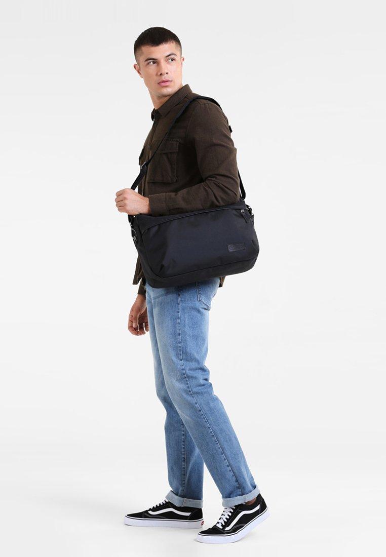 Eastpak - BARTECH - Across body bag - constructed black