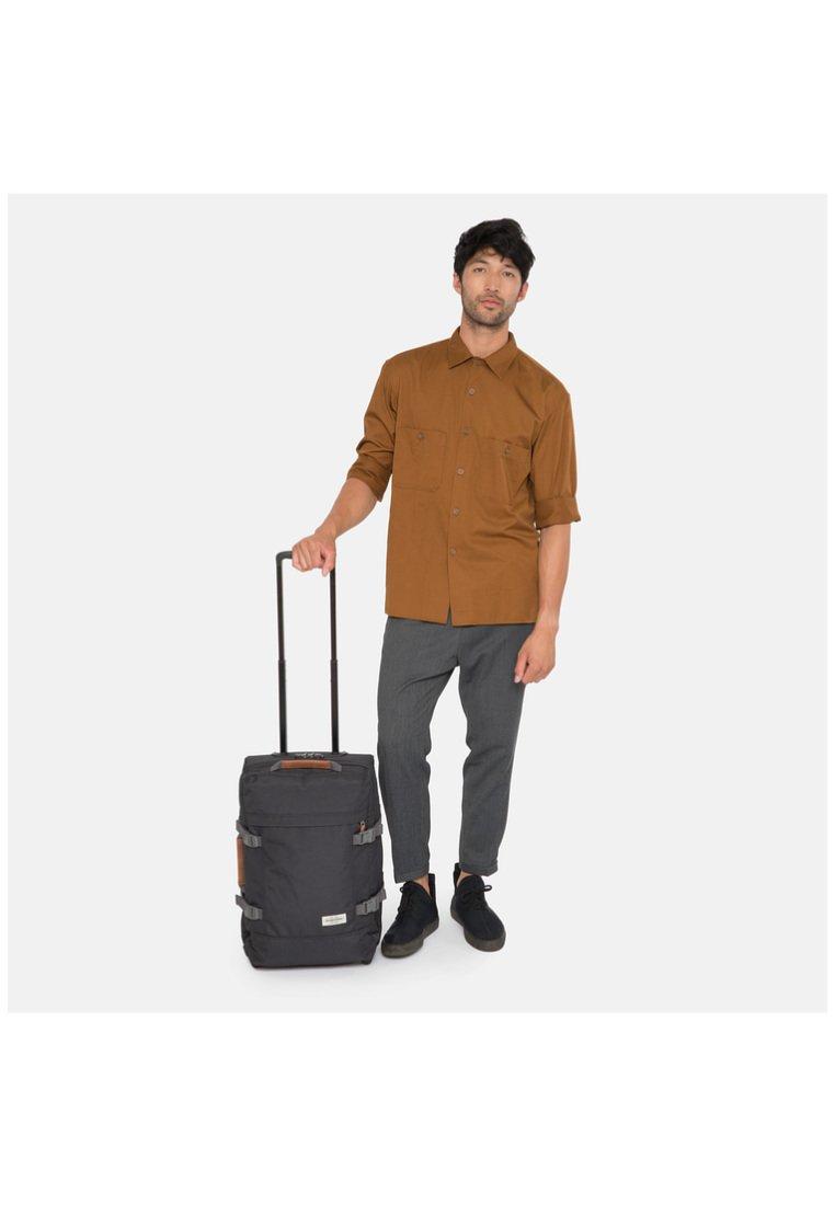 Eastpak - TRANVERZ S OPGRADE - Wheeled suitcase - black/ocher