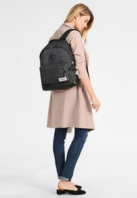 Eastpak - WYOMING INTO THE OUT - Rucksack - into black yarn - 1