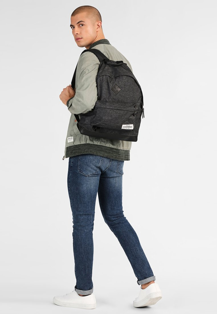 Eastpak - WYOMING INTO THE OUT - Rucksack - into black yarn