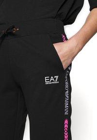 EA7 Emporio Armani - TROUSER - Pantaloni sportivi - black - 4