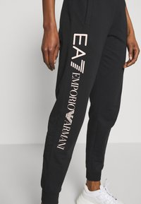 EA7 Emporio Armani - TROUSER - Tracksuit bottoms - black peach - 3