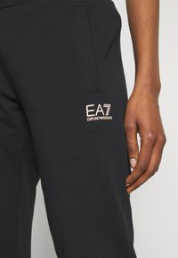 EA7 Emporio Armani - TROUSER - Tracksuit bottoms - black peach - 5