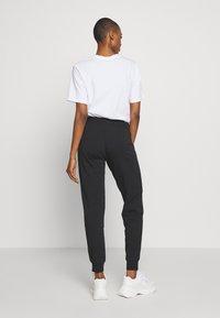 EA7 Emporio Armani - TROUSER - Pantalon de survêtement - black peach - 2