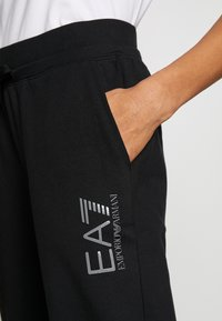EA7 Emporio Armani - TROUSER - Tracksuit bottoms - black/grey
